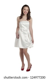 Portrait of a happy teenager in white dress isolated on a white background
