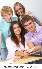 Portrait of happy teens looking at camera with smiles in classroom