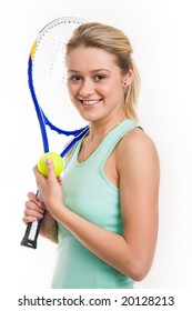Portrait of happy tennis player with racket and ball in hands looking at camera