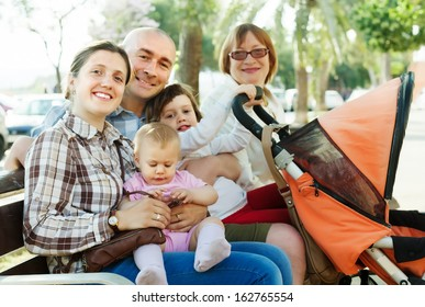 Portrait of happy three generations family   in sunny summer day