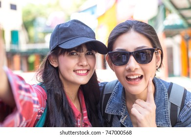 Portrait of Happy traveler Woman Selfie with friend together in city. Asian women using Smartphone with Happy emotions, Woman with Travel Concept.