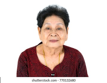 portrait of happy very old smile black hair asian chinese thai woman grandmother. isolated on white background. wear red shirt, gold necklace, diamond earring.