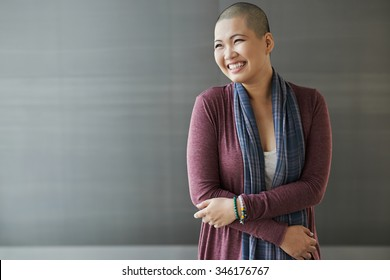 Portrait of happy Vietnamese breast cancer survivor