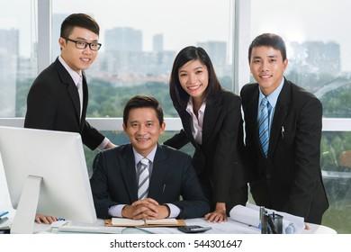 Portrait of happy Vietnamese business team in office