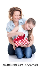 Portrait of happy  white mother and young daughter looking into the box with gift - isolated.