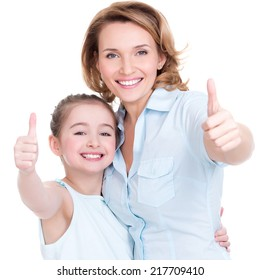 Portrait of happy  white mother and young daughter with thumbs up - isolated. Happy family people concept.
