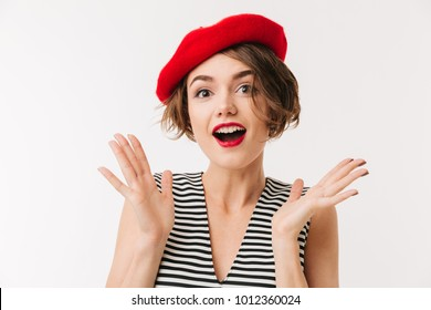 Portrait of a happy woman dressed in red beret screaming and looking at camera isolated over white background
