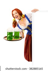 Portrait of a Happy Woman Dressed a Traditional St. Patrick's Day Costume Holding a Huge  Green Beer Glass Isolated on White Background