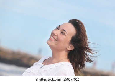 portrait of a happy woman outdoors