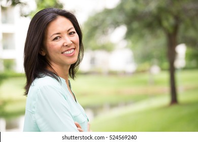 Portrait of happy woman outside.