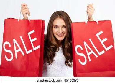 Portrait of happy woman with purchases from sale