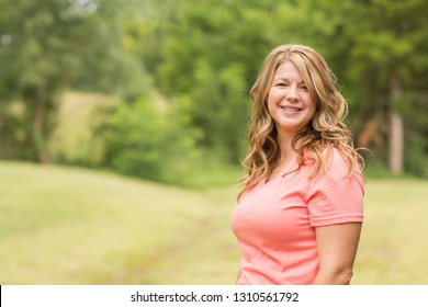 Portrait of a happy woman smiling standing outside.