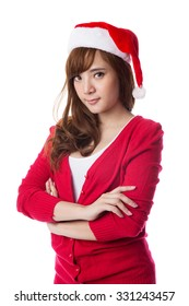 Portrait of happy woman wearing christmas Santa hat, isolated on white background.