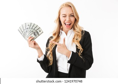 Portrait of happy woman wearing office clothing holding fan of money isolated over white background