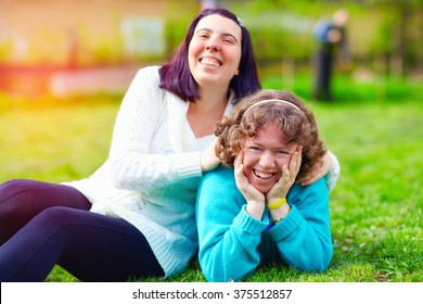 portrait of happy women with disability on spring lawn