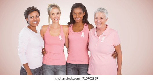 Portrait of happy women supporting breast cancer social issue against neutral background