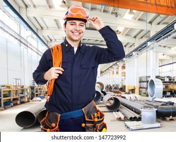 Portrait of an happy worker in a factory