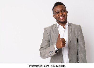 Portrait of happy young African businessman giving thumbs up
