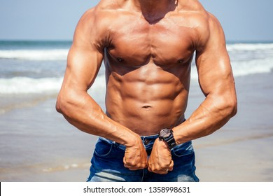 27efd802 portrait of happy young african man on the beach.Handsome and confident  Masculine hard fitness