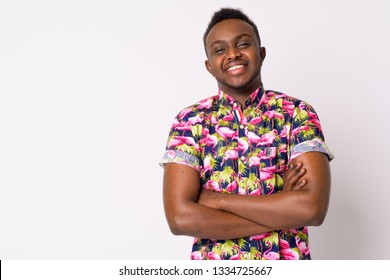 Portrait of happy young African tourist man smiling with arms crossed