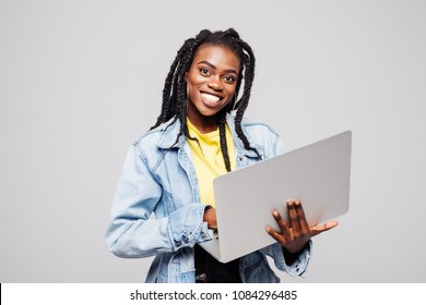 Portrait of happy young afro american woman using laptop computer isolated over white