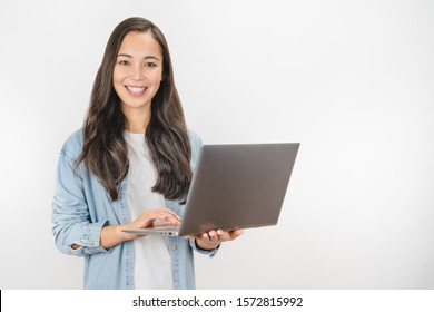 Portrait of happy young asian girl using laptop computer isolated over white background