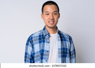 Portrait of happy young Asian hipster man smiling