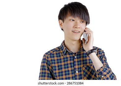 Portrait Of Happy Young Asian Man Talking On Cell Phone Isolated On White Background