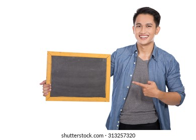 A portrait of happy young asian man holding blackboard on white background