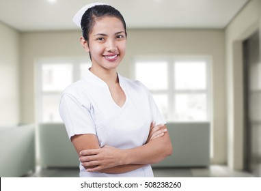 Portrait of a happy young asian nurse.
