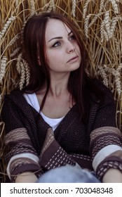 Portrait of happy young beautiful woman brunette in field wheat sunset evening