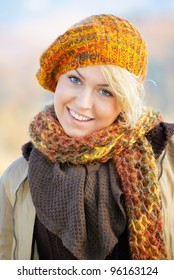 Portrait of a happy young blonde outdoor in the countryside.