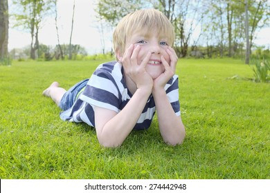 Portrait of a happy young boy in the garden