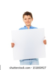 Portrait of happy young boy holding blank white sign plate