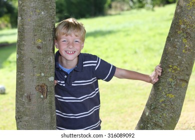 Portrait of a happy young boy outdoors