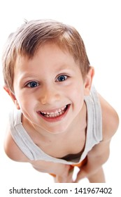 Portrait of happy young boy with white studio background and copy space.
