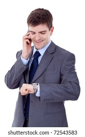 Portrait of a happy young business man checking time while speaking on cellphone