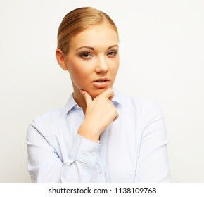 Portrait of happy young business woman over white background