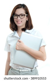 Portrait of happy young business woman with laptop isolated on white background