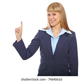 Portrait of a happy young business woman pointing at something interesting over white background
