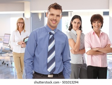 Portrait of happy young businessman and his team.