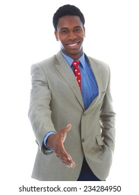 Portrait of happy young businessman offering handshake over white background