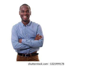 Portrait of happy young businessman smiling against isolated white background