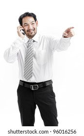 portrait of a happy young businessman talking on mobile phone