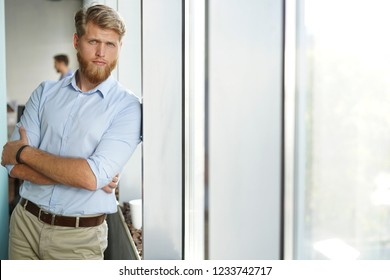 Portrait of a happy young casual businessman at office.