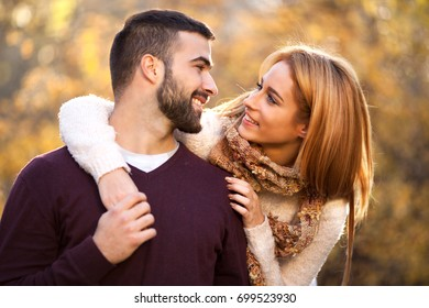 Portrait of a happy young couple enjoying a day in the park together