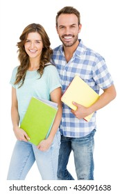 Portrait of happy young couple holding book and folder on white background