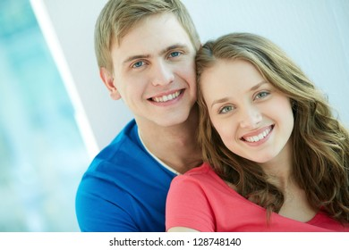 Portrait of happy young couple looking at camera