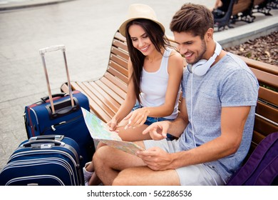 Portrait of happy young couple  with map finding way to town