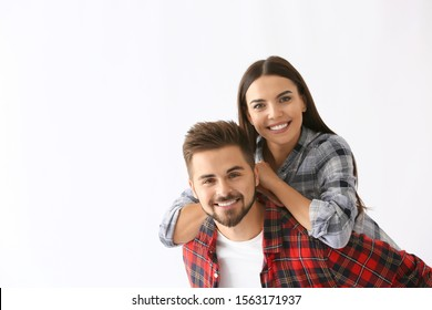 Portrait of happy young couple on white background